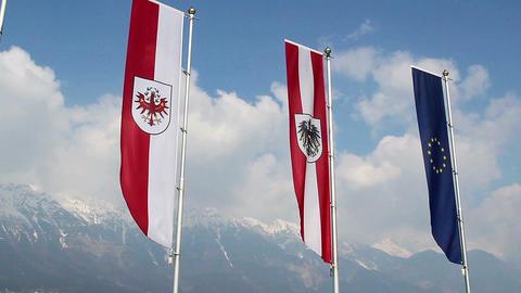 EU, Austrian, Tyrol flags wave, popular European mountain resort Live Action