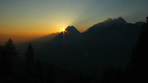 Amazing sunset, sun slowly hiding behind mountain time-lapse Footage