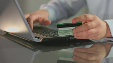 Man paying bill, shopping online, inserting credit card number Footage