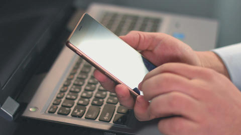 Closeup of male hands scrolling, typing message on smartphone Live Action