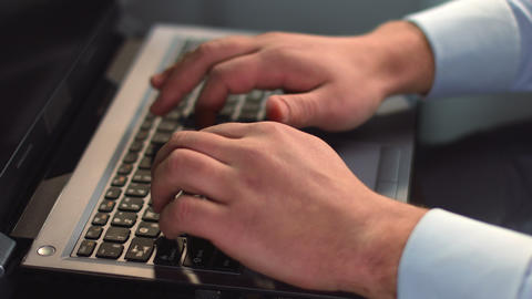 Businessman hands typing on laptop, pressing buttons on keyboard Footage