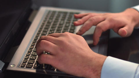Male office employee typing, working on laptop, using touchpad Footage