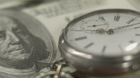One hundred dollar bill, pocket watch closeup. Time is money Footage