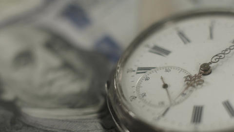 U.S. one hundred dollar bill, pocket watch. Time, money system Footage