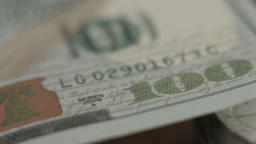 New 100 dollar bill U.S. paper money closeup, counterfeit note Footage