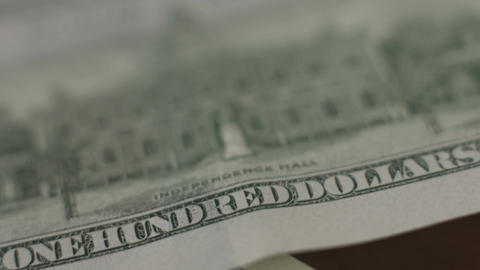In God we trust motto on one hundred-dollar bill, closeup Footage