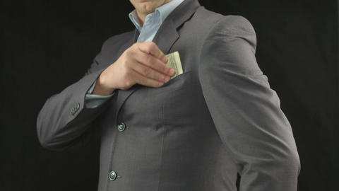 Man business suit hiding dollars in pocket, money saving, income Footage