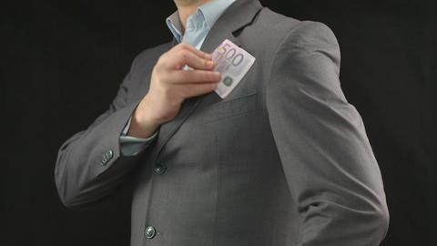 Businessman putting money in pocket. Finances, success, startup Footage