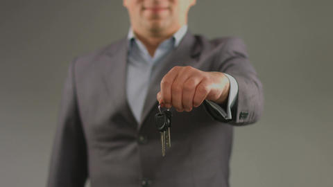 Male hands hold keys. Renting car, apartment, real estate agent Footage