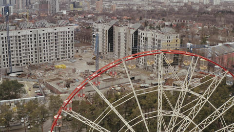 Approaching aerial shot of the famous Ferris wheel in Kharkov in Gorky Park and Live Action