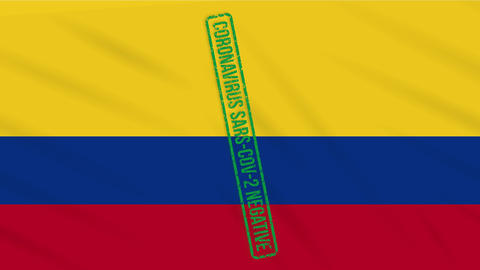 Colombia swaying flag with a green stamp of freedom from coronavirus, loop Animation