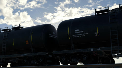 Oil tankers are transported by rail against a bright blue overcast sky Animation
