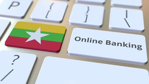 Online Banking text and flag of Myanmar on the keyboard. Internet finance Live Action