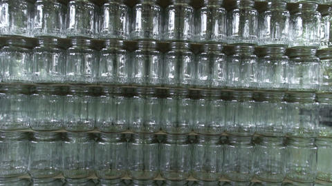 Empty Glass cans in factory storage. Canning plant. Canned vegetables Live Action