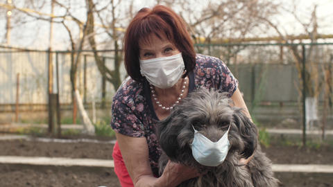 Dog with mistress in protective masks Live Action
