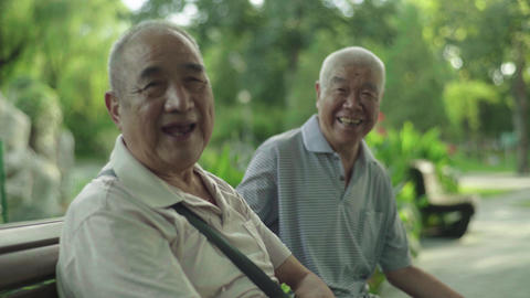 Two pensioners in the park. Beijing. China. Asia Live Action