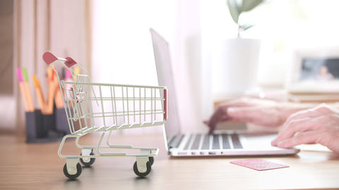 Boxes with EXPRESS SHIPPING text fall in shopping cart after ordering by Acción en vivo