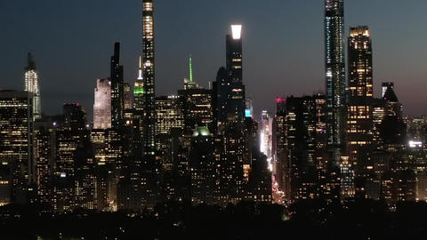 AERIAL: Time Lapse Hyper Lapse over New York City Central Park at Night with Live Action