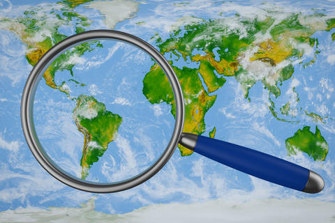 map and a magnifying glass Photo