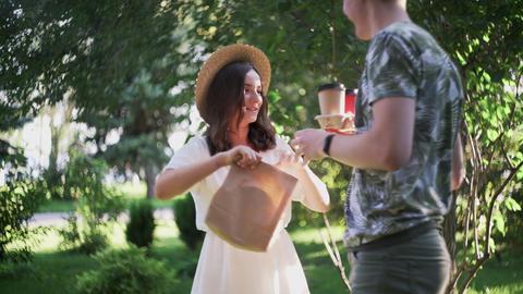 Young lovely meeting in park in the summer Acción en vivo