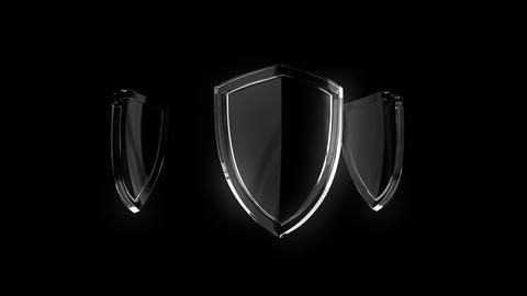 3d animation of glass shield rotating, sign of protection, defense and security on black background GIF