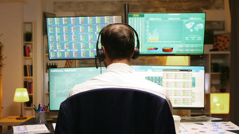 Back view of investor trading stocks online Live Action