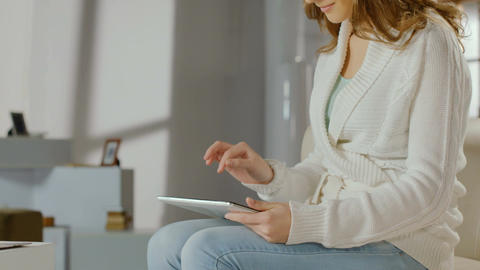 Woman using tablet PC at home, chatting online, watching movies Footage