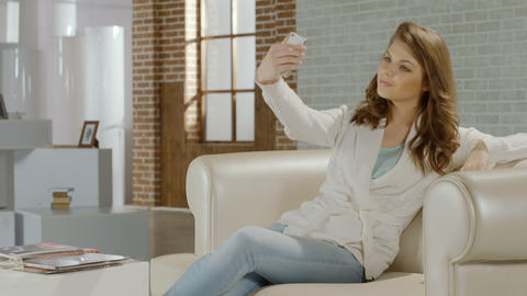 Beautiful girl making selfie on smartphone, sharing on instagram Footage