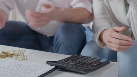 Closeup hands with calculator, husband wife plan family budget Footage