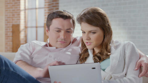 Excited wife husband shopping online at home. Family business Footage