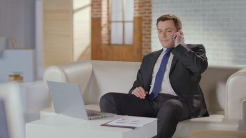 Real estate broker calling client, starting phone conversation Footage