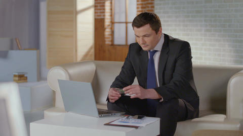 Rich man business suit inserting credit card number on laptop Footage