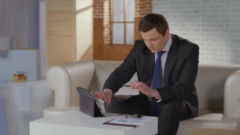 Office worker enters credit card number on tablet mobile banking Footage