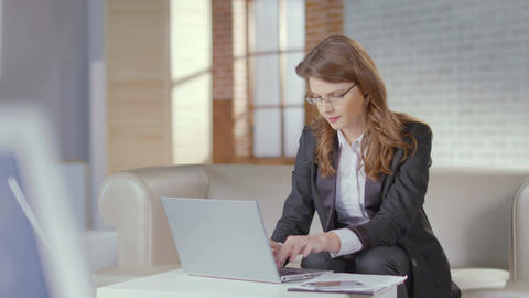 Attractive woman business suit working in office, using laptop Footage