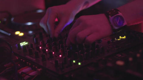 Male deejay playing club music, professional sound equipment Footage