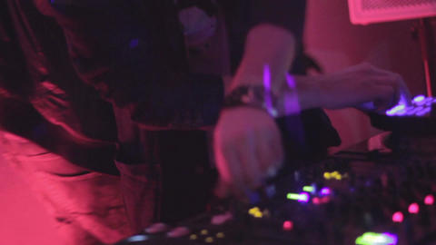 DJ playing music, turning controls on electronic sound equipment Footage