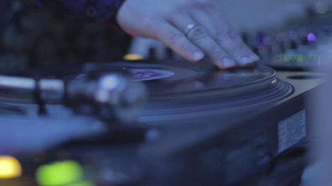 DJ mixing records, playing music, hands scratching vinyl platter Footage