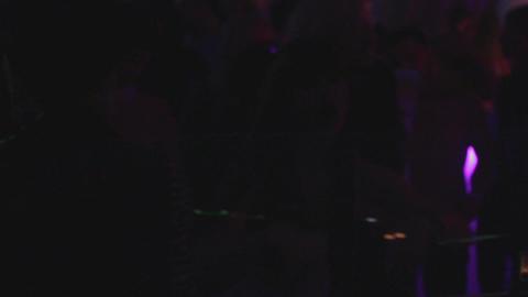 Dark silhouettes, people dancing, dj playing, club atmosphere Footage