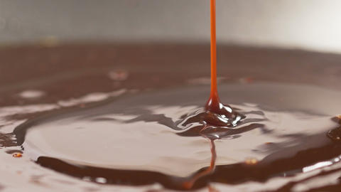 Delicious melted chocolate syrup pouring Footage