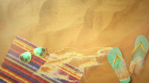 Closeup sandy beach with sandal and sunglasses, summer background Animation