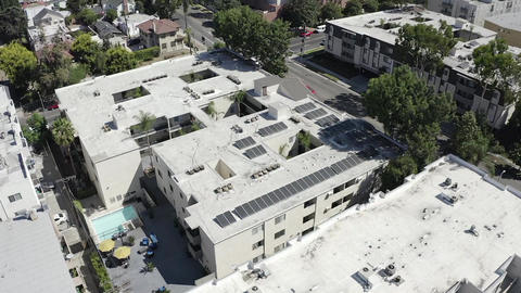 Aerial view orbiting real estate apartment complex neighborhood, Los Angeles Live Action