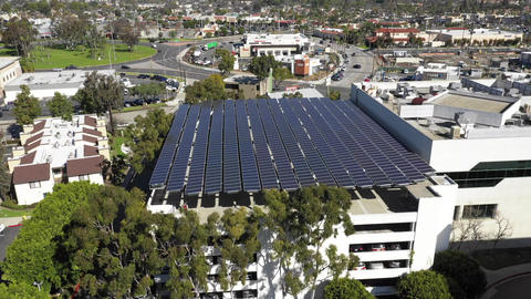 Large solar panels, parking structure, aerial renewable green energy, Long Beach Live Action