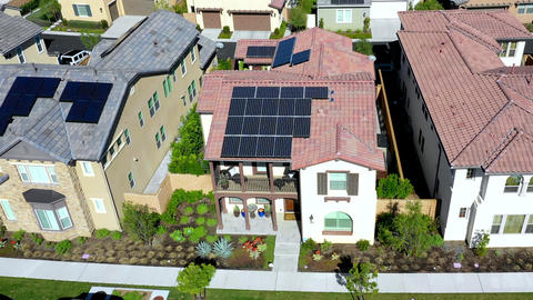 Aerial pull back, residential houses, solar panels technology of neighborhood Live Action