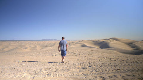Man walking in the Imperial Sand Dunes alone, Glamis, California Live Action