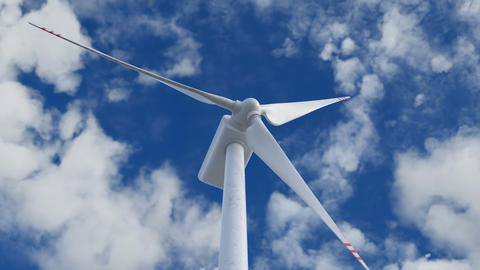 A wind turbine generates clean energy against a beautiful blue sky Animation