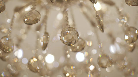 Extreme close-up of bright golden ceiling shade in expensive accommodations Live Action