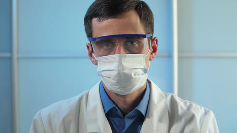 Physician in protective glasses and mask Live Action