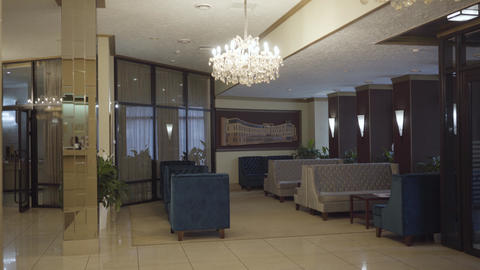 Wide shot of luxurious lounge zone in high-class hotel lobby. Comfortable Live Action