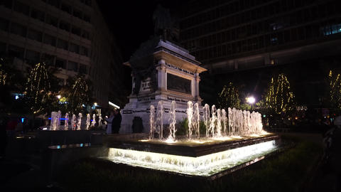 Granada, Spain - January, 2020: Isabela I with Christopher Columbus statue and fountain, in Granada. Live Action