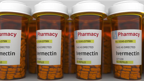 Pharmacy vials with ivermectin generic drug pills as a possible coronavirus Live Action